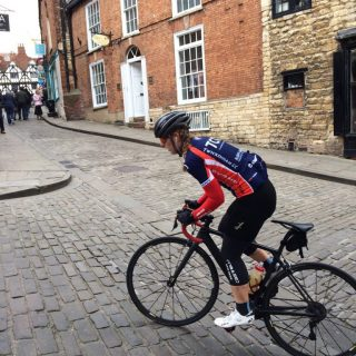 Hannah Nicklin, on the bike, just at the top of Michaelgate, on a recce of the Lincoln GP course